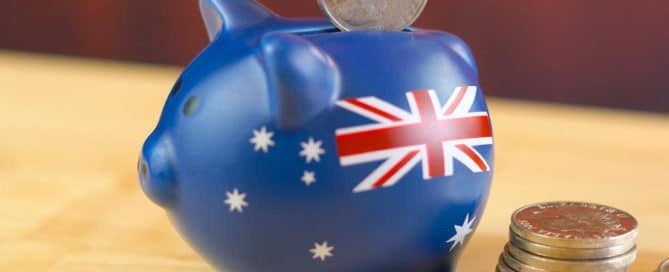 Australian piggy bank and coins savings concept. Closeup macro shallow DOF.