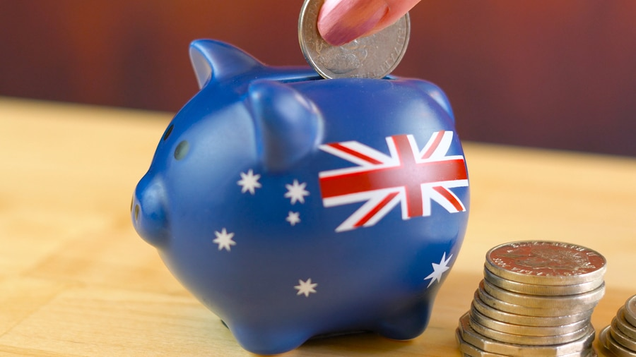 Australian piggy bank and coins savings concept, closeup macro shallow DOF.